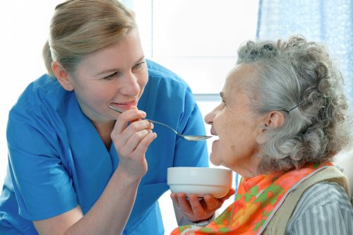 Nurse Feeding an Elderly Woman in Memphis, TN